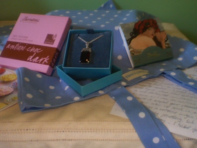 Dark chocolate, vintage-esque necklace, ethical tote, pretty notebook, and of course, a love letter.